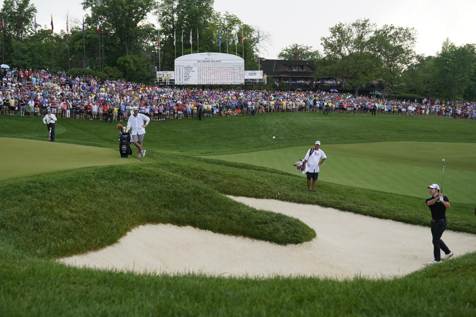 Patrick Cantlay hits out of a bunker during the first playoff hole during the final round of the Memorial golf tournament, Sunday, June 6, 2021, in Dublin, Ohio. (AP Photo/Darron Cummings)