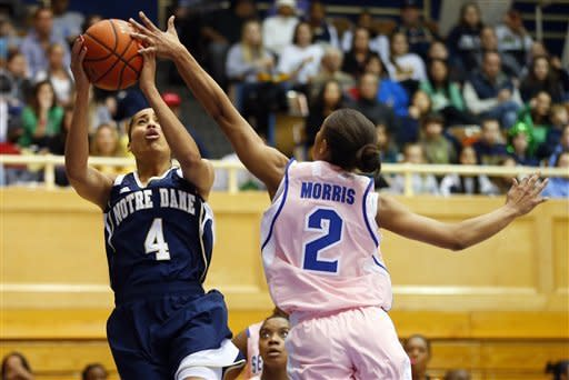 Notre Dame's Skylar Diggins (4) attempts a shoot as Seton Hall's Brittany Morris (2) defends during the first half of an NCAA college basketball game in South Orange, N.J. Saturday, Feb. 9, 2013. (AP Photo/Rich Schultz)