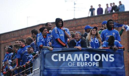 Chelsea football club's Russian owner Roman Abramovich (front centre) sits amongst Chelsea players as they parade through London following their 2012 FA Cup and Champions League victory. Andre Villas Boas's bitterness at his sacking by Chelsea last season surfaced again on Sunday as he said his new club Spurs did not seek out scapegoats if they were going through a bad patch