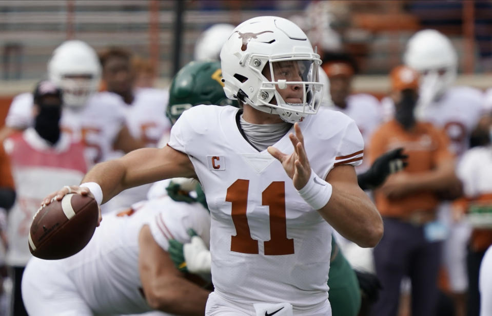 FILE - In this Oct. 24, 2020, file photo, Texas' Sam Ehlinger looks to pass against Baylor during the first half of an NCAA college football game in Austin, Texas. Kansas State and Texas Tech changed starting quarterbacks midseason for much different reasons. While true freshman quarterbacks are now starting for the two Big 12 teams in the Sunflower State of Kansas, and No. 18 Oklahoma is led by redshirt freshman Spencer Rattler, the senior seasons for Sam Ehlinger at No. 21 Texas and Charlie Brewer at Baylor don't necessarily have to be the end of their college careers. (AP Photo/Chuck Burton, File)