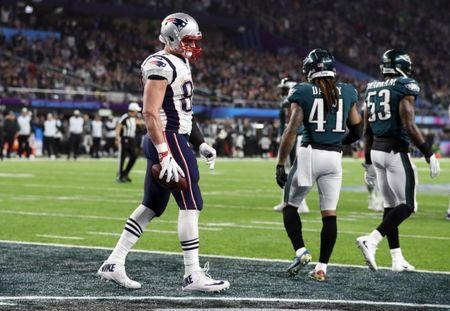 FILE PHOTO: NFL Football - Philadelphia Eagles v New England Patriots - Super Bowl LII - U.S. Bank Stadium, Minneapolis, Minnesota, U.S. - February 4, 2018. New England Patriots' Rob Gronkowski celebrates scoring a touchdown. REUTERS/Chris Wattie