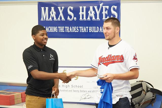 "<a class=""link rapid-noclick-resp"" href=""/mlb/players/9122/"" data-ylk=""slk:Trevor Bauer"">Trevor Bauer</a> visits Max Hayes High School to deliver his donation of $69,420.69 on his 69th Day of Giving last season. (Dan Mendlik/Cleveland <a class=""link rapid-noclick-resp"" href=""/mlb/teams/cleveland/"" data-ylk=""slk:Indians"">Indians</a>)"