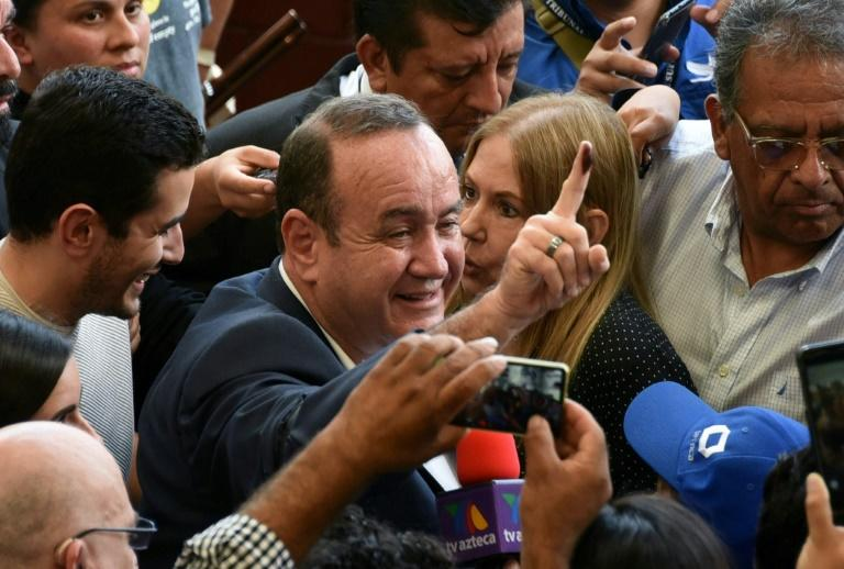 Conservative Alejandro Giammattei declared victory in Guatemala's run-off presidential election (AFP Photo/ORLANDO ESTRADA)