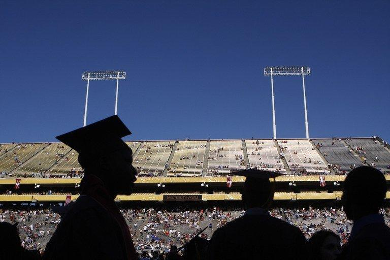 University students are silhouetted during their graduation on May 13, 2009, in Tempe, Arizona