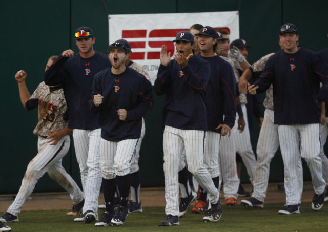 The Pepperdine bench comes out to celebrate a game tieing run in the seventh inning of an NCAA college baseball tournament regional game against Cal Poly on Saturday, May 31, 2014, at Baggett Stadium at Cal Poly in San Luis Obispo, Calif. (AP Photo/Aaron Lambert)