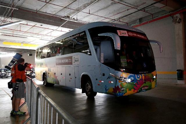 The United States team bus rolls through a tunnel before an official training session the day before the group G World Cup soccer match between Ghana and the United States at the Arena das Dunas in Natal, Brazil, Sunday, June 15, 2014. (AP Photo/Julio Cortez)