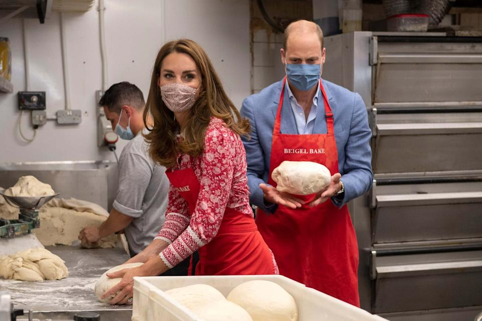 Prince William and Kate, Duchess of Cambridge knead dough during a visit to the Beigel Bake: AP