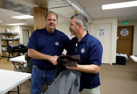 Sam Daniels (L) and Mike Evans of the International Association of Machinists and Aerospace Workers, shake hands at IAM headquarters after workers rejected union representation at the Boeing South Carolina plant in North Charleston, South Carolina, U.S. February 15, 2017. REUTERS/Randall Hill