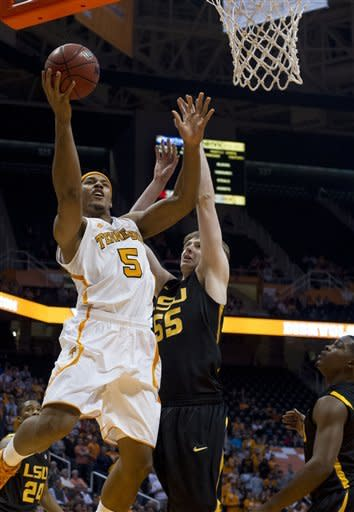 Tennessee's Jarnell Stokes attempts to score while defended by LSU's Andrew Del Piero during the first half of an NCAA college basketball game Tuesday, Feb. 19, 2013, in Knoxville, Tenn. (AP Photo/The Knoxville News Sentinel, Saul Young)