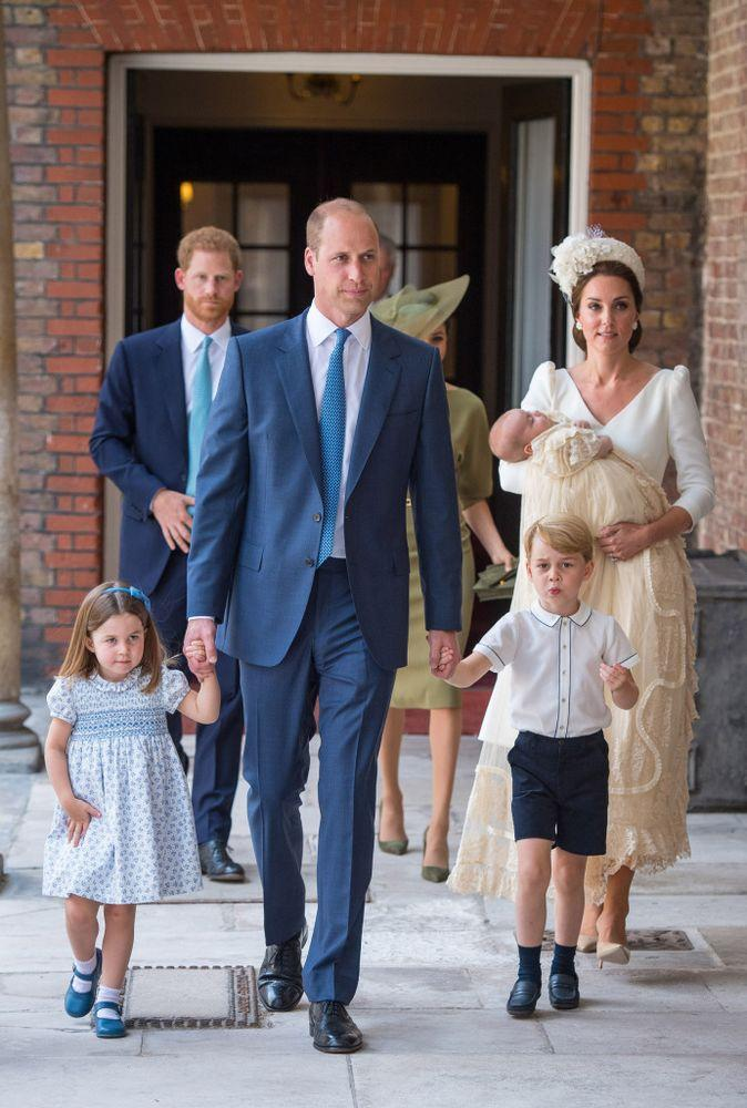Princess Charlotte and Prince George hold the hands of their father while entering Chapel Royal, St. James's Palace, London for the christening of their brother, Prince Louis, who is carried by their mother, Kate Middleton.