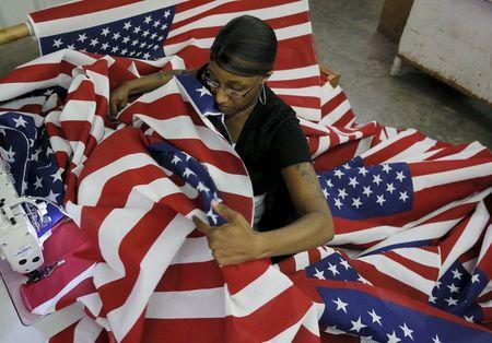 Keisha Hardman cuts and sews U.S. flags at Valley Forge's manufacturing facility in Lane, South Carolina June 23, 2015. REUTERS/Brian Snyder