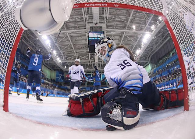 USA goaltender Madeline Rooney grabs the puck after Finland scored during the Olympic opener. (Getty)