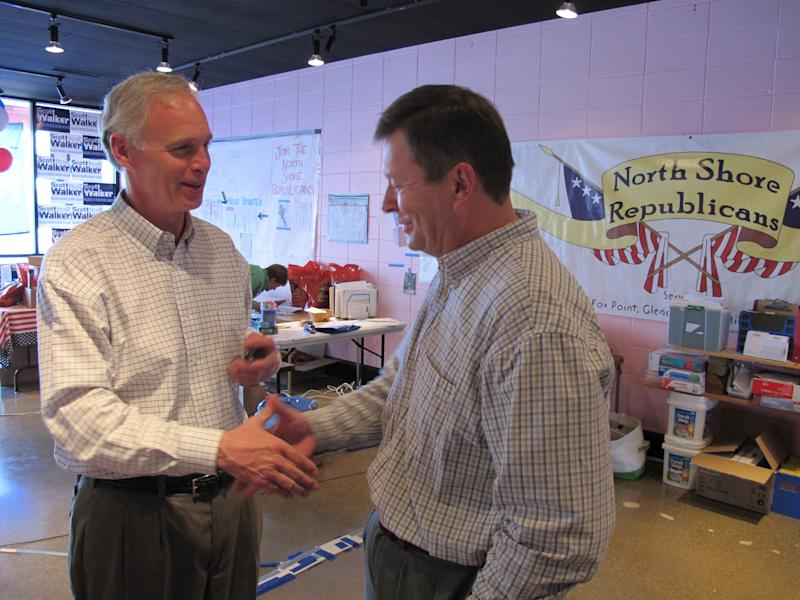 Republican U.S. Senate challenger Ron Johnson thanks a supporter for making phone calls on his behalf on Monday, Nov. 1, 2010, at a GOP campaign office in the Milwaukee suburb of Glendale, Wis.   (AP Photo/Dinesh Ramde)