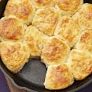 """<p>No Thanksgiving would be complete without a skillet of warm biscuits. This recipe is slightly sweet thanks to the cinnamon-honey butter. </p><p><a href=""""https://www.thepioneerwoman.com/food-cooking/recipes/a34776142/skillet-biscuits-with-cinnamon-honey-butter/"""" rel=""""nofollow noopener"""" target=""""_blank"""" data-ylk=""""slk:Get Ree's recipe."""" class=""""link rapid-noclick-resp""""><strong>Get Ree's recipe.</strong></a></p>"""
