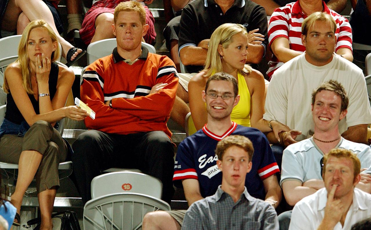 07 Jan 2001:   South African cricket players Shaun Pollock and Jacques Kallis (top row) enjoy the Andy Roddick and Andrew Ilie match with partners during the Adidas International  held at the Sydney International Tennis centre, Homebush Bay, Sydney, Australia.  DIGITAL IMAGE Mandatory Credit: Chris McGrath/Getty Images