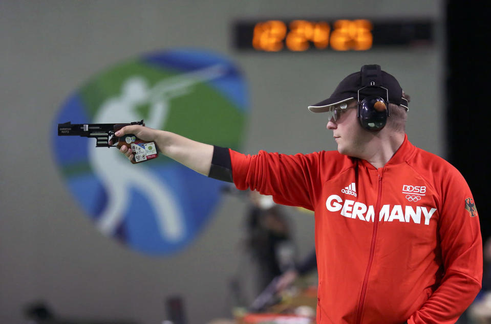 <p>Christian Reitz of Germany competes in the men's 25m rapid fire pistol final at the Olympic Shooting Centre in Rio on August 13, 2016. (REUTERS/Edgard Garrido) </p>