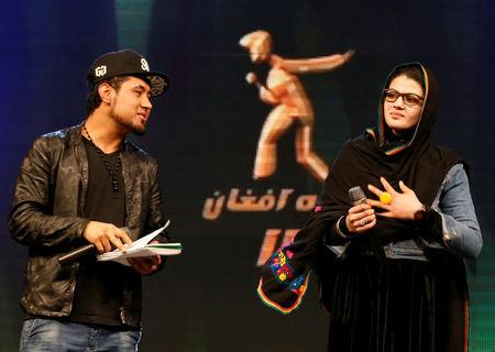 Zulala Hashimi, 18 (R) and Sayed Jamal Mubarez, 23 (L) singer finalists of the music contest 'Afghan Star', rehearse for the show in Kabul, Afghanistan March 19, 2017. REUTERS/Mohammad Ismail