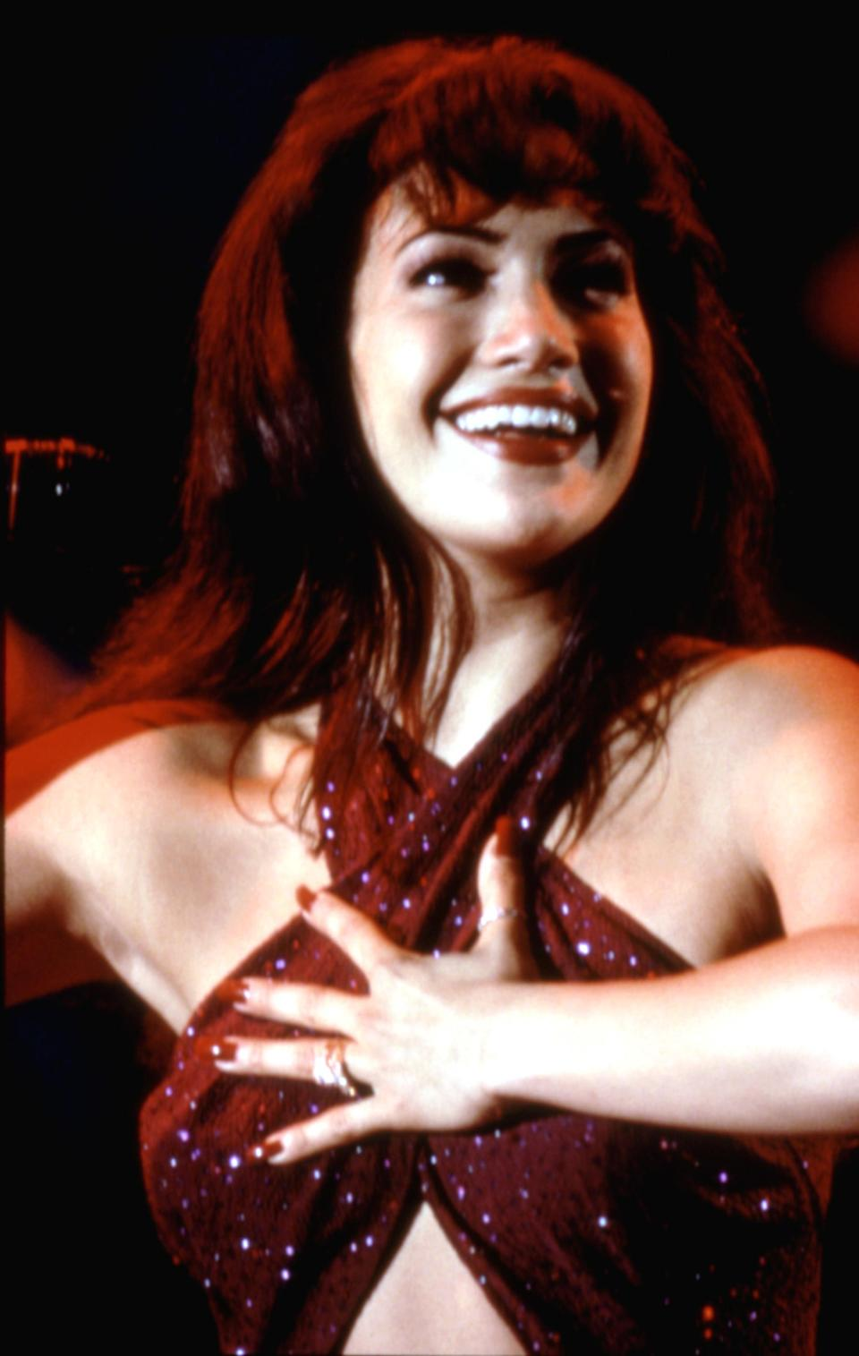 Selena performing in a jumpsuit in the film