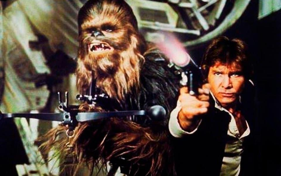 Peter Mayhew as Chewbacca, left, and Harrison Ford as Hans Solo in the original 1977