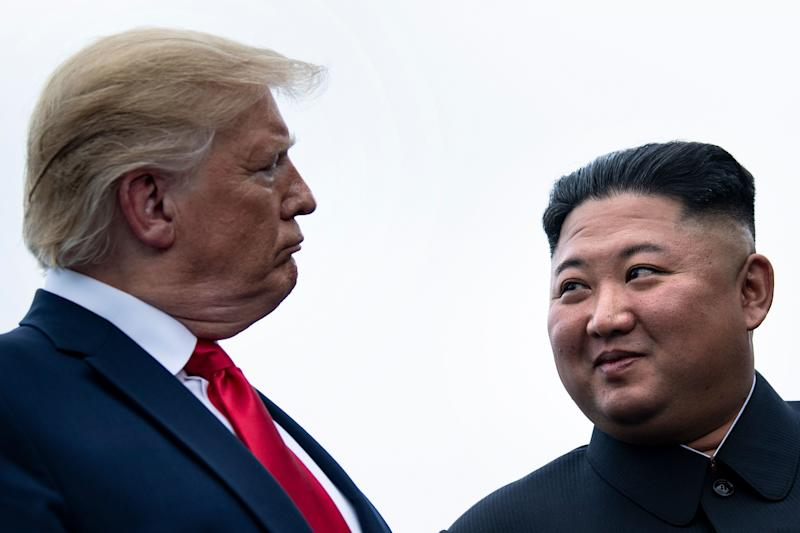 President Donald Trump and North Korea's leader, Kim Jong Un, talk before a meeting in the Demilitarized Zone on June 30, 2019, in Panmunjom. (Photo: BRENDAN SMIALOWSKI/AFP via Getty Images)
