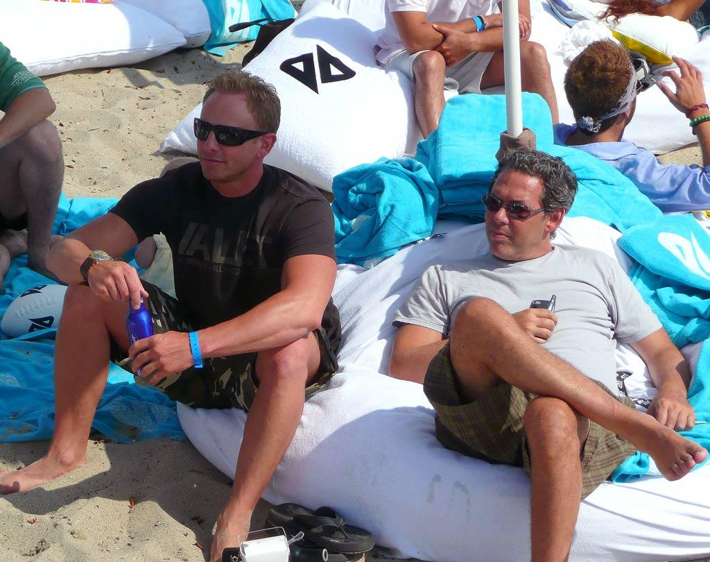 Ian Ziering relaxes on the beach with some buds. omg! staff/Polaroid Malibu Beach House - July 23, 2007