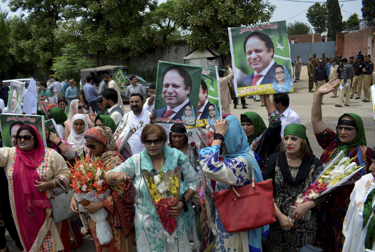 Supporters of Pakistan's jailed ex-Prime Minister Nawaz Sharif gather outside the Adiala jail where he is being held, in Rawalpindi, Pakistan, Thursday, July 19, 2018. A spokesman for the political party of Sharif, the Pakistan Muslim League, said Thursday that the former leader is being held in deplorable conditions as he awaits the outcome of his appeal over a 10-year sentence on corruption charges. (AP Photo/B.K. Bangash)