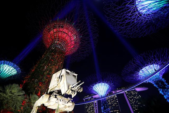 "<p>A Star Wars AT-ST replica is displayed as Supertrees structures transform into ""light sabers"" during activities to mark the ""May the 4th be with you"" Star Wars Day at Gardens by the Bay in Singapore, May 4, 2017. (Photo: Edgar Su/Reuters) </p>"