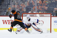 New York Islanders' Thomas Greiss (1) block a shot by Philadelphia Flyers' Claude Giroux (28) during a shootout in an NHL hockey game, Saturday, Nov. 16, 2019, in Philadelphia. New York won 4-3 in a shootout. (AP Photo/Matt Slocum)