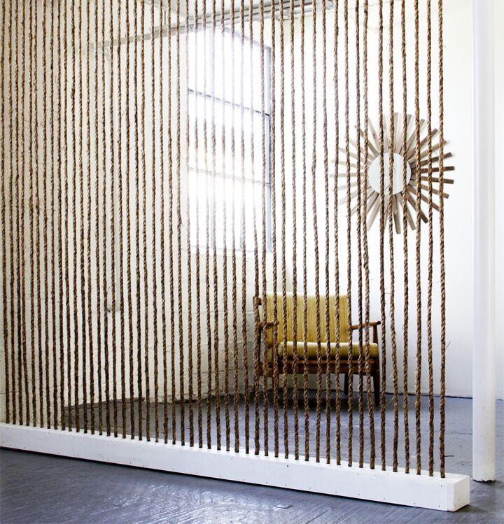 """<p>Add texture and style to your space with this DIY vertical jute rope division wall. This is a great solution for those seeking to create defined spaces while still retaining light and visibility.</p><p><strong>Get the tutorial at <a href=""""http://www.the-brick-house.com/2011/05/rope-wall/"""" target=""""_blank"""">The Brick House</a>. </strong></p><p><a class=""""body-btn-link"""" href=""""https://www.amazon.com/Twisted-Natural-Nautical-Landscaping-Decorations/dp/B07RFC7RMW/ref=sr_1_7?tag=syn-yahoo-20&ascsubtag=%5Bartid%7C10050.g.30755770%5Bsrc%7Cyahoo-us"""" target=""""_blank"""">SHOP JUTE ROPE</a></p>"""