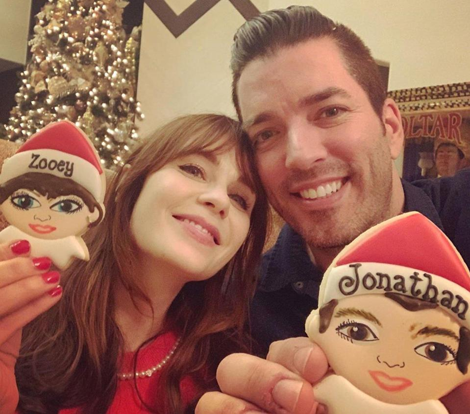 """The couple spent their first Christmas together and celebrated with some baking! """"When you surround yourself with amazing, creative people...the result is magical,"""" Scott <a href=""""https://www.instagram.com/p/B6YolVeJS4j/"""" rel=""""nofollow noopener"""" target=""""_blank"""" data-ylk=""""slk:captioned a photo"""" class=""""link rapid-noclick-resp"""">captioned a photo</a> of the pair holding up Christmas cookies."""