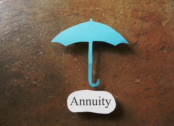 """A blue umbrella over the word """"annuity"""""""