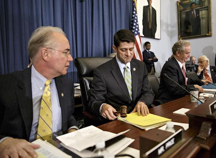 House Budget Committee Chairman Rep. Paul Ryan, R-Wis., center, flanked by committee member Rep. Tom Price, R-Ga., left, and the committee's ranking member Rep. Chris Van Hollen, D-Md., begins the markup of budget plan that would slash $5.1 trillion in federal spending over coming decade and promises to balance the government's books with wide-ranging cuts in programs like food stamps and government-paid health care for the poor and working class, Wednesday, April 2, 2014, on Capitol Hill in Washington. (AP Photo/J. Scott Applewhite)