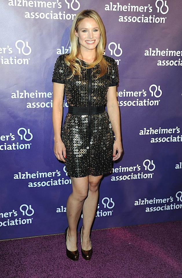 "Back in LA, Kristen Bell sparkled at the 19th Annual ""A Night At Sardi's"" fundraiser thanks to her grommet-covered SEA NY mini and metallic Brian Atwood pumps. Frazer Harrison/<a href=""http://www.gettyimages.com/"" target=""new"">GettyImages.com</a> - March 16, 2011"