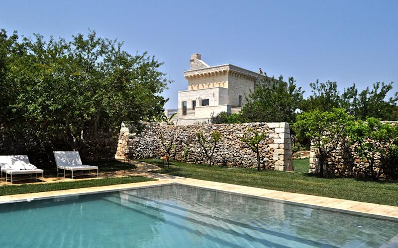 Masseria Trapana is a 16th-century farmhouse repurposed into a sophisticated eight-suite hotel with verdant walled gardens