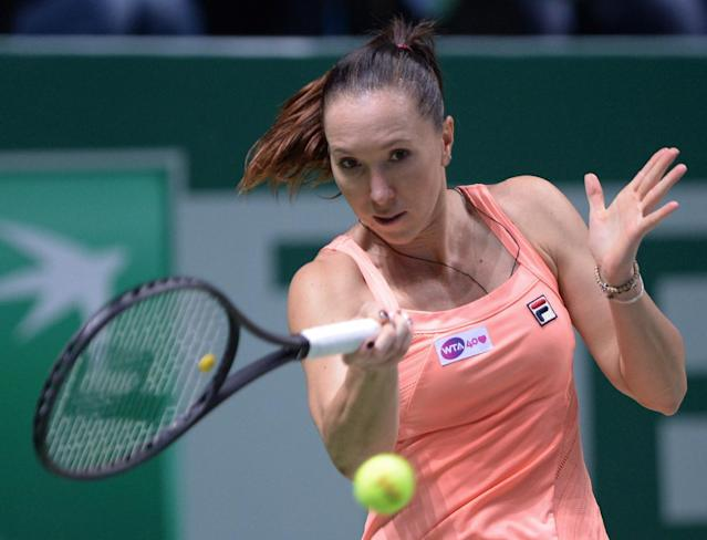 Jelena Jankovic of Serbia returns a shot to Serena Williams of the USA during their semifinal tennis match at the WTA Championship in Istanbul, Turkey, Saturday, Oct. 26, 2013. The world's top female tennis players compete in the championships which runs from Oct. 22 until Oct. 27.(AP Photo)