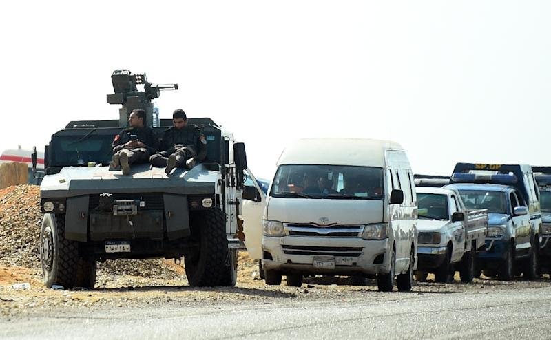 An Egyptian armoured vehicle is seen on the road to the Bahariya oasis after a deadly shootout between police and militants (AFP Photo/MOHAMED EL-SHAHED)
