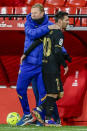 Barcelona's head coach Ronald Koeman embraces Barcelona's Lionel Messi after being substituted during the Spanish La Liga soccer match between Granada and FC Barcelona at the Los Carmenes stadium in Granada, Spain, Saturday, Jan. 9, 2021. (AP Photo/Jose Breton)
