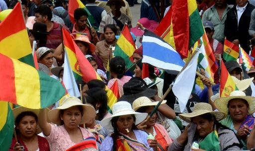 Pro-government Quechua indigenous women rallied in Cochabamba, where demonstrators fought a pitched battle with government opponents