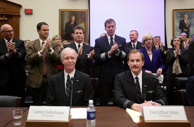 Capt. Chesley Sullenberger III, left, and First Officer Jeffrey Skiles receive applause before the start of a House Transportation and Infrastructure Committee hearing on Capitol Hill, Feb. 24, 2009. (Photo: Mark Wilson/Getty Images)