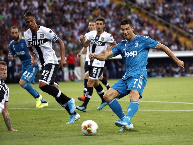 Juventus' Cristiano Ronaldo, right, kicks the ball during the Serie A soccer match between Parma and Juventus at the Tardini stadium, in Parma, Italy, Saturday, Aug. 24, 2019. (AP Photo/Antonio Calanni)