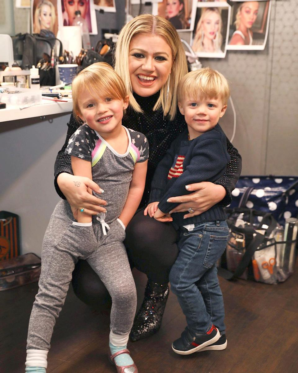 """<p><a href=""""https://people.com/tag/kelly-clarkson/"""" rel=""""nofollow noopener"""" target=""""_blank"""" data-ylk=""""slk:Kelly Clarkson"""" class=""""link rapid-noclick-resp"""">Kelly Clarkson</a> says being a mother makes her """"Stronger.""""</p> <p><a href=""""https://people.com/tag/the-voice/"""" rel=""""nofollow noopener"""" target=""""_blank"""" data-ylk=""""slk:The Voice"""" class=""""link rapid-noclick-resp""""><i>The Voice</i></a> coach is mother to son <a href=""""https://people.com/parents/kelly-clarkson-welcomes-son-remington-alexander/"""" rel=""""nofollow noopener"""" target=""""_blank"""" data-ylk=""""slk:Remington &quot;Remy&quot; Alexander"""" class=""""link rapid-noclick-resp"""">Remington """"Remy"""" Alexander</a>, 4, and daughter <a href=""""https://people.com/parents/kelly-clarkson-welcomes-daughter-river-rose/"""" rel=""""nofollow noopener"""" target=""""_blank"""" data-ylk=""""slk:River Rose"""" class=""""link rapid-noclick-resp"""">River Rose</a>, 6.</p> <p>Clarkson at the <a href=""""https://people.com/parents/kelly-clarkson-wine-is-necessary-when-raising-kids-reveals-baby-plans/"""" rel=""""nofollow noopener"""" target=""""_blank"""" data-ylk=""""slk:NBCUniversal Winter 2018 TCA press tour"""" class=""""link rapid-noclick-resp"""">NBCUniversal Winter 2018 TCA press tour</a> talked about how her children teach her to be a better version of herself.</p> <p>""""[Kids] are challenging. Wine is necessary. They're great though. Out of the mouths of babes. They say stuff where you're like 'Damn.' They call you out,"""" said Clarkson. """"I know it sounds silly but kids teach you to be a better human. They're watching every moment, not only me at home but me sitting here with y'all.""""</p> <p>She added, """"I'm going to teach my kids to do what they love, regardless if they're the most famous person doing it. Love what you do. Love who you work with and don't work with people you don't and don't do things you don't love.""""</p>"""