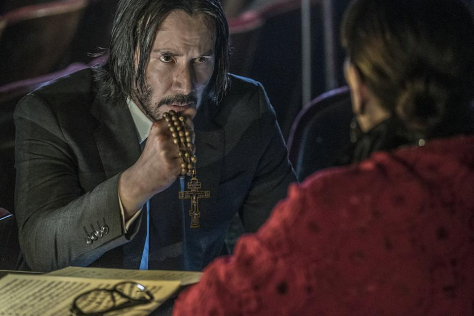 """Keanu Reeves has been everywhere this year, shooting a <em>Bill & Ted</em> sequel and keeping a busy schedule as the Internet's Boyfriend™, even if <a href=""""https://uk.movies.yahoo.com/keanu-reeves-not-aware-internet-boyfriend-samara-weaving-144104054.html"""" data-ylk=""""slk:he's not aware of it;outcm:mb_qualified_link;_E:mb_qualified_link;ct:story;"""" class=""""link rapid-noclick-resp yahoo-link"""">he's not aware of it</a>. No wonder people are searching for the movie in which he kills a load of criminals with library books. (Credit: Lionsgate)"""