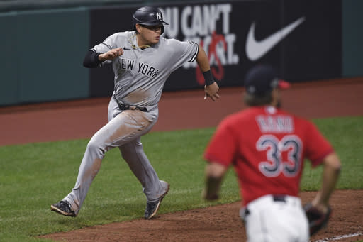 New York Yankees' Gio Urshela runs home to score during the ninth inning of Game 2 of the team's American League wild-card baseball series against the Cleveland Indians, early Thursday, Oct. 1, 2020, in Cleveland. The Yankees won 10-9. (AP Photo/David Dermer)