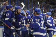 Tampa Bay Lightning players celebrate after defeating the New York Islanders in Game 7 of an NHL hockey Stanley Cup semifinal playoff series Friday, June 25, 2021, in Tampa, Fla. (AP Photo/Chris O'Meara)