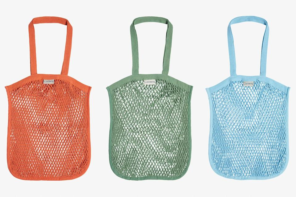 """Perfect for stashing in a rollaway or even storing produce, this sturdy yet lightweight organic cotton tote is a staple for <a href=""""https://www.cntraveler.com/story/beach-vacation-packing-list?mbid=synd_yahoo_rss"""" rel=""""nofollow noopener"""" target=""""_blank"""" data-ylk=""""slk:beach days"""" class=""""link rapid-noclick-resp"""">beach days</a>, farmer's market hauls, and impromptu weekend jaunts. And since it takes up next to no space, it's a great bag to stash in your suitcase for future souvenir shopping. $18, Caraway. <a href=""""https://www.carawayhome.com/products/market-tote?variant=32114773917778"""" rel=""""nofollow noopener"""" target=""""_blank"""" data-ylk=""""slk:Get it now!"""" class=""""link rapid-noclick-resp"""">Get it now!</a>"""
