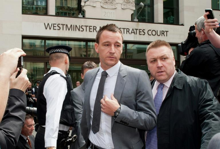 Chelsea footballer John Terry (C) leaves Westminster Magistrates court in London, on July 13, 2012 as he was found not guilty of racially abusing rival footballer Anton Ferdinand