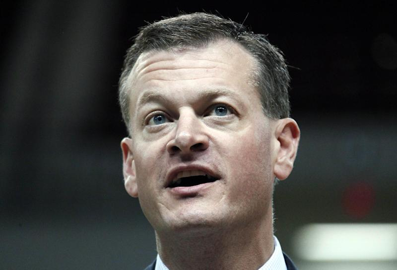 In this photo taken April 2, 2012, Mississippi State athletic director Scott Stricklin speaks during a news conference in Starkville, Miss. Stricklin said he understands why there are raised eyebrows at the amount of money floating around college football. The Bulldogs are right in the middle of the cash grab as part of the behemoth Southeastern Conference _ recently announcing a $75 million expansion of Davis Wade Stadium that will push its capacity to 61,337 seats (AP Photo/Rogelio V. Solis)