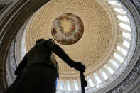 A statue of President George Washington stands in the U.S. Capitol Rotunda, Tuesday, March 2, 2021, in Washington. (AP Photo/Patrick Semansky)