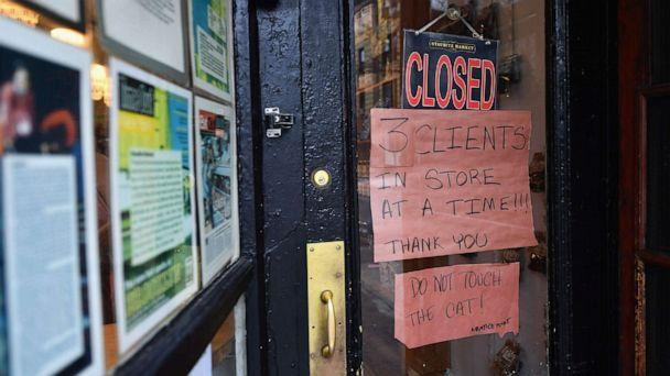 PHOTO: A sign outside a local butcher limits the number of customers in the shop, on March 20, 2020, in the Brooklyn borough of New York. (Angela Weiss/AFP via Getty Images)