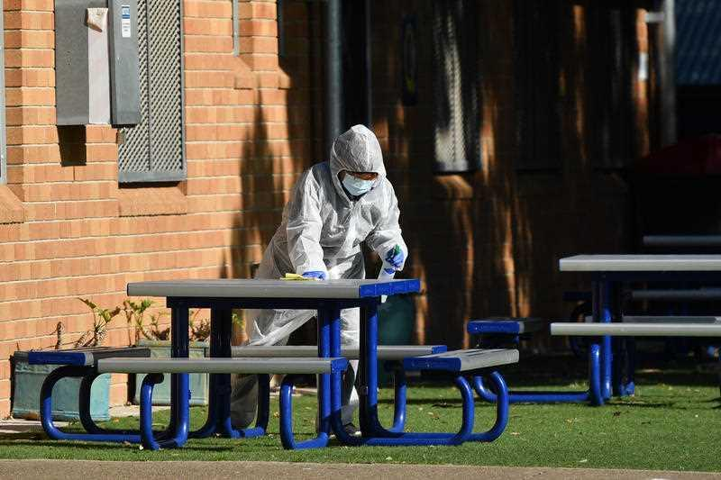 Cleaners in personal protective equipment at Strathfield South Public School in Sydney